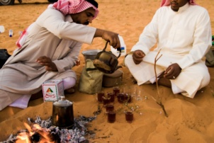 Bedouins making evening tea, desert near the oasis Al Ula, Saudi Arabia